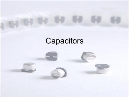 Capacitors. Demo Capacitors in every day use – Keynote [ lab power supply, ac/dc voltage converter/radio/tv/computer/VCR/ throwaway flash camera] A capacitor.