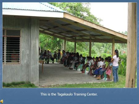 This is the Tagakaulo Training Center.. A literacy teacher hands out certificates.