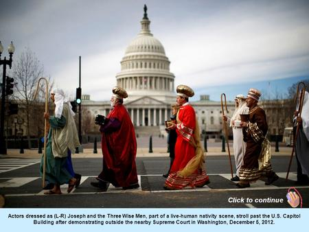 Actors dressed as (L-R) Joseph and the Three Wise Men, part of a live-human nativity scene, stroll past the U.S. Capitol Building after demonstrating.