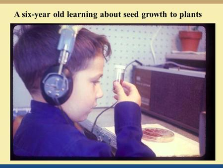 A six-year old learning about seed growth to <strong>plants</strong>.