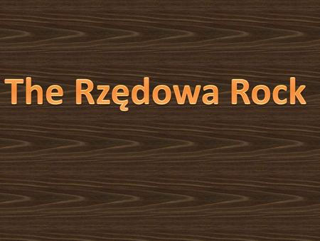 It is placed on the north-east of Bzów, near the paved path leading to Kidów. There, a large rock is situated called the Rzędowa Rock.