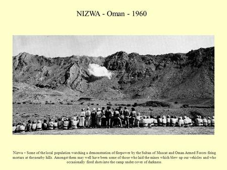 NIZWA - Oman - 1960 Nizwa – Some of the local population watching a demonstration of firepower by the Sultan of Muscat and Oman Armed Forces firing mortars.