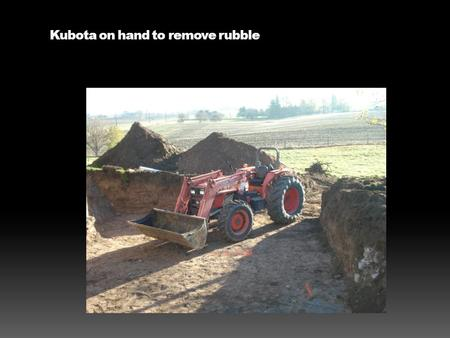 Kubota on hand to remove rubble. Farmall H with tilt trailer.