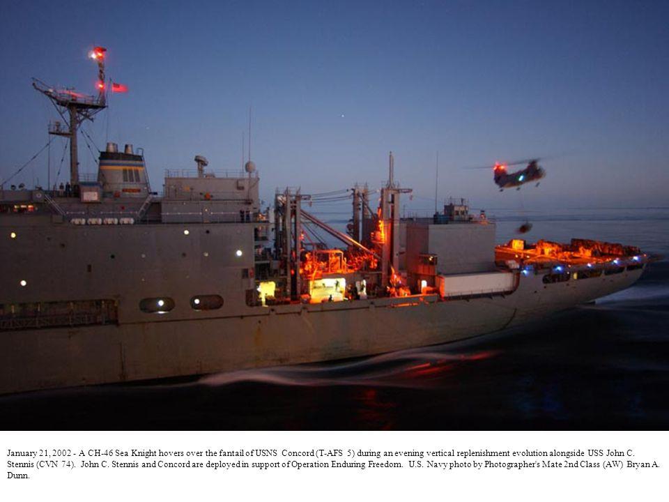 January 29, 2002 - Under the night amber lights of the USS John C.