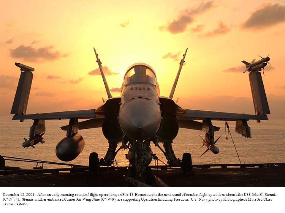 December 29, 2001 - As the sun rises on the deck of USS John C.