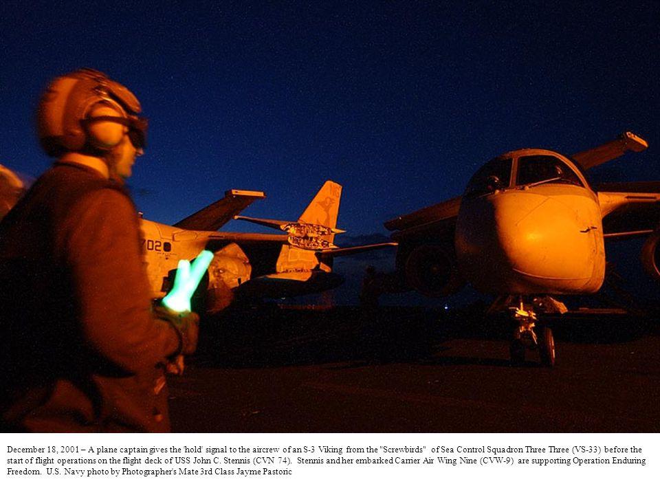December 18, 2001 -- An Aviation Ordnanceman on the flight deck of USS John C.