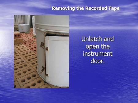 Unlatch and open the instrument door. Removing the Recorded Tape.