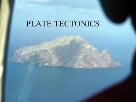 PLATE TECTONICS. The theory is that the earth's surface is covered by a number of relatively thin plates which move over the material below. Plate Tectonics.
