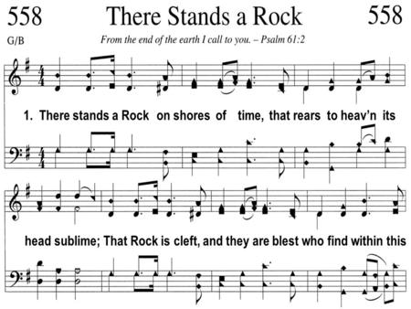1.  There stands a Rock   on shores  of    time,  that rears  to heav'n  its