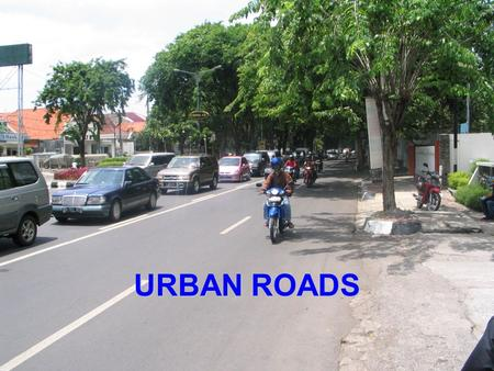 URBAN ROADS. Scope of Urban Roads Urban/Suburban Road Segments  continuous permanent development along all or almost of its length, on at least one side.