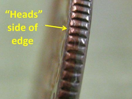 """Heads"" side of edge. Diameter of human hair 5 meters."