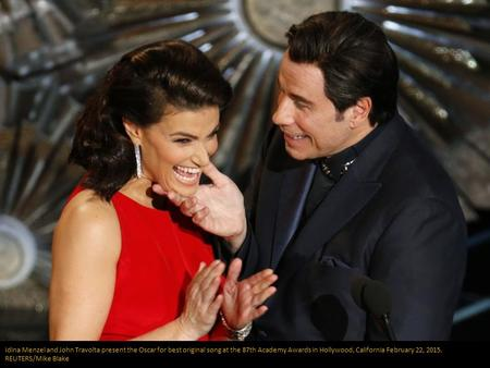 Idina Menzel and John Travolta present the Oscar for best original song at the 87th Academy Awards in Hollywood, California February 22, 2015. REUTERS/Mike.