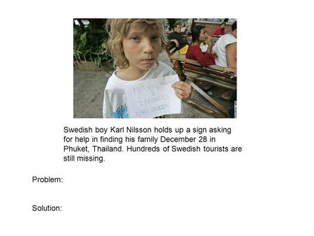 Swedish boy Karl Nilsson holds up a sign asking for help in finding his family December 28 in Phuket, Thailand. Hundreds of Swedish tourists are still.