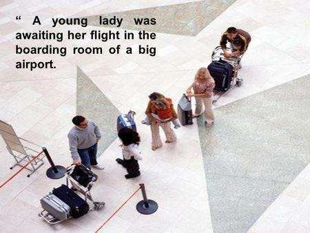 """ A young lady was awaiting her flight in the boarding room of a big airport."