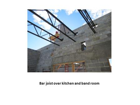 Bar joist over kitchen and band room. Setting bar joist over kitchen and electrical/mechanical rooms.