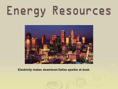 Electricity makes downtown Dallas sparkle at dusk.