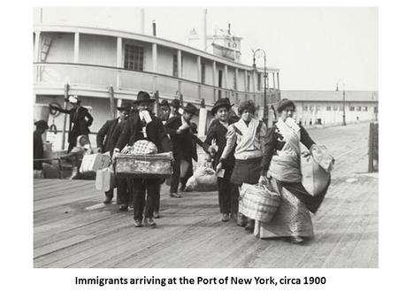 Immigrants arriving at the Port of New York, circa 1900.