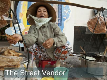 "The Street Vendor. ""I pray for my health,"" says Mai as she scans the crowd looking for potential customers walking along the street. ""I work every day."