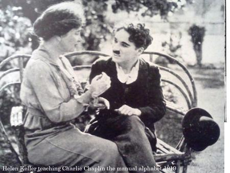 Helen Keller teaching Charlie Chaplin the manual alphabet 1919