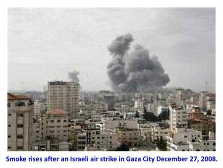 Smoke rises after an Israeli air strike in Gaza City December 27, 2008.