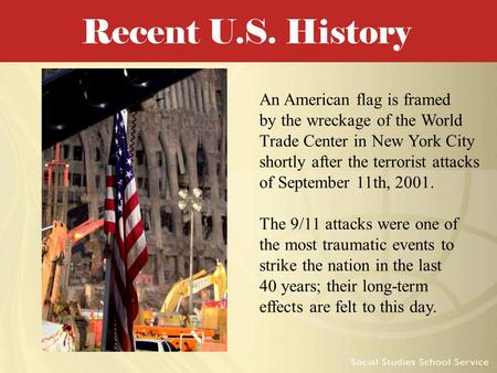 An American flag is framed by the wreckage of the World Trade Center in New York City shortly after the terrorist attacks of September 11th, 2001. The.