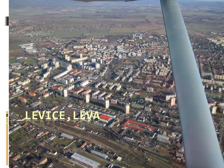 The town lies on the left bank of the Hron River.  It is the main town of the Levice District, which is the largest district in Slovakia.  The town's.