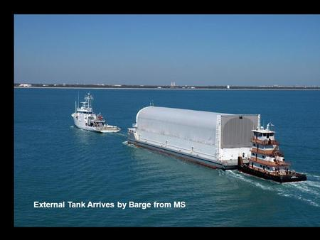 External Tank Arrives by Barge from MS. Vertical Assembly Building External Tank.