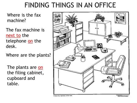 Where is the fax machine? The fax machine is next to the telephone on the desk. The plants are on the filing cabinet, cupboard and table. Where are the.
