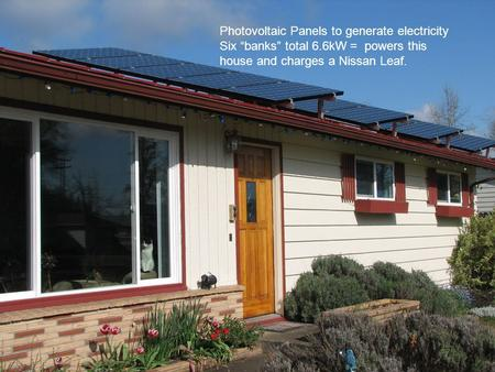 "Photovoltaic Panels to generate electricity Six ""banks"" total 6.6kW = powers this house and charges a Nissan Leaf."