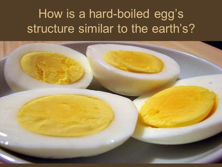 How is a hard-boiled egg's structure similar to the earth's?