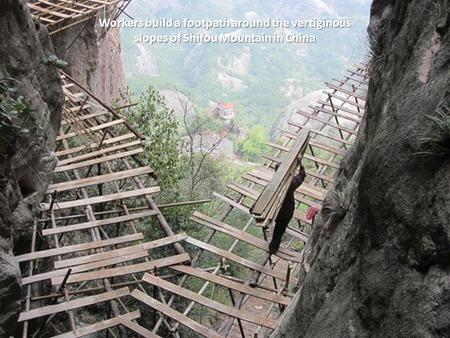 Workers build a footpath around the vertiginous slopes of Shifou Mountain in China.