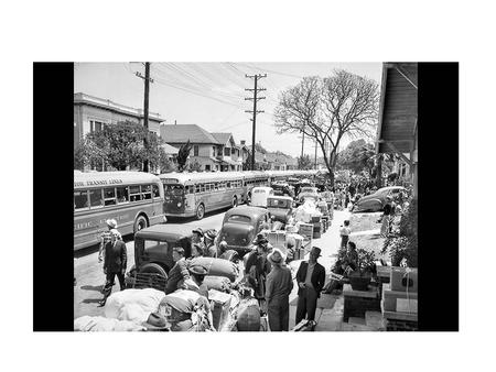 April 30, 1942: Buses line up at 23rd Street and Vermont Avenue to carry 600 Japanese to the temporary internment camp at Santa Anita racetrack. This.