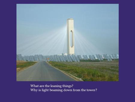 What are the leaning things? Why is light beaming down from the tower?
