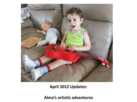 April 2012 Updates: Alma's artistic adventures. Alma explored drawing and colouring in on large paper (top) and drawing with chalk on a small board (right)