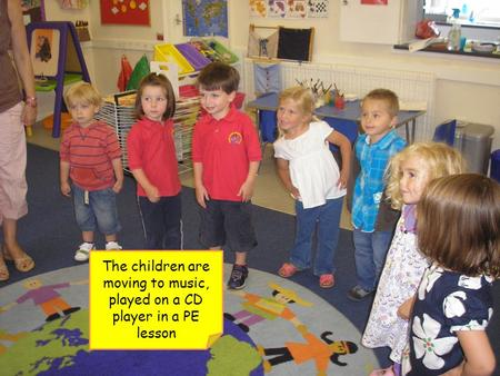 The children are moving to music, played on a CD player in a PE lesson.