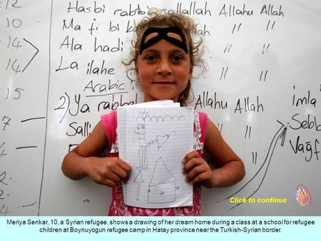Meriya Senkar, 10, a Syrian refugee, shows a drawing of her dream home during a class at a school for refugee children at Boynuyogun refugee camp in Hatay.