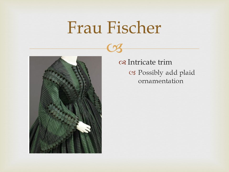  Frau Fischer  Cut and style of cape  Would have plaid pattern  See color palette for colors of tartan