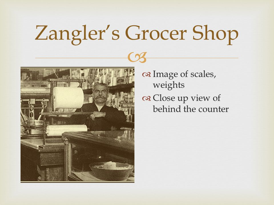  Zangler's Grocer Shop  Large view of inside of a general store  Walls lined with shelves, one long counter