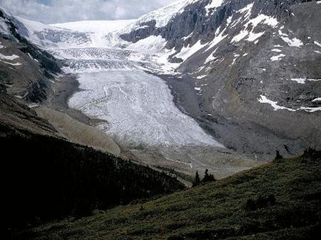 Erosion and Deposition Glaciers ● Glacier - a large mass of ice that moves over land ● Alpine glaciers – occur in mountain and are erosional ● Continental.