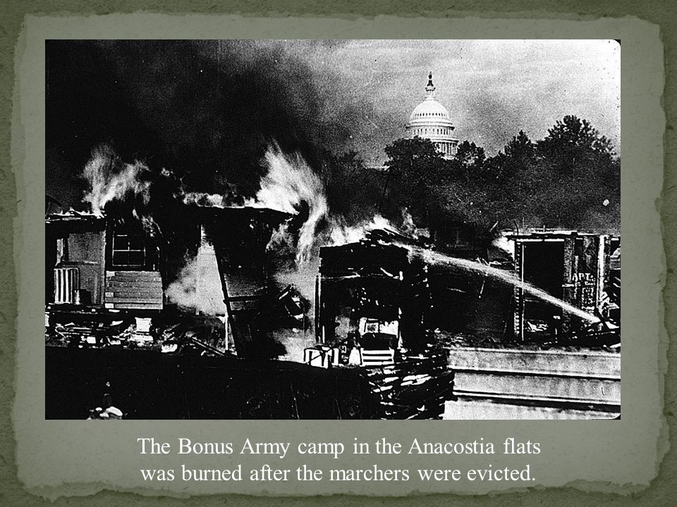 US Army soldiers stand guard over the burned out Bonus Army camp.
