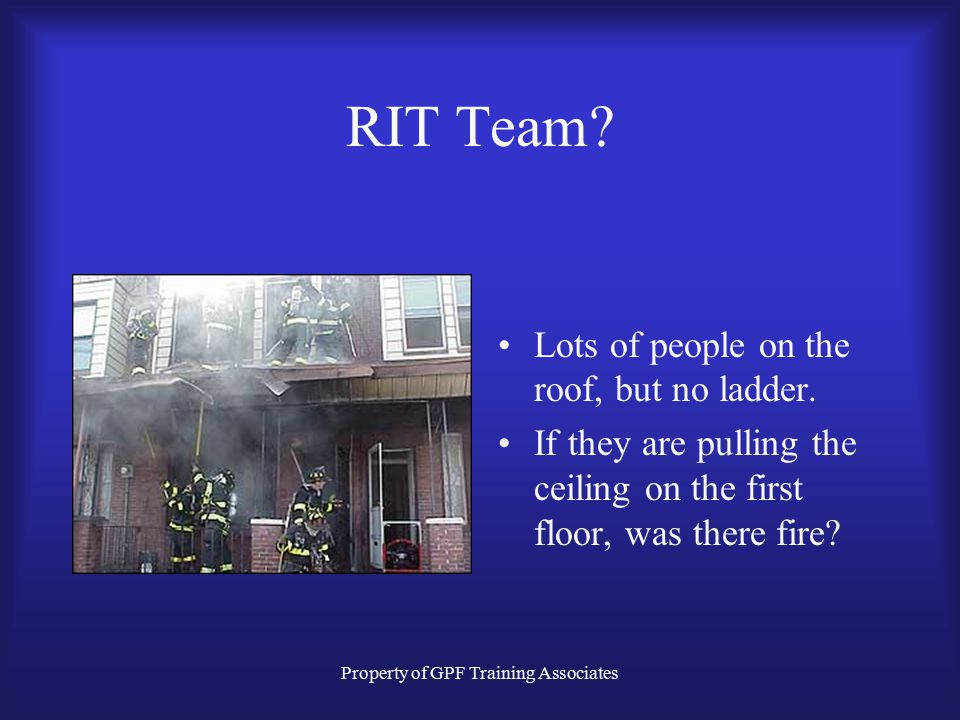 Property of GPF Training Associates RIT Team.Lots of people on the roof, but no ladder.