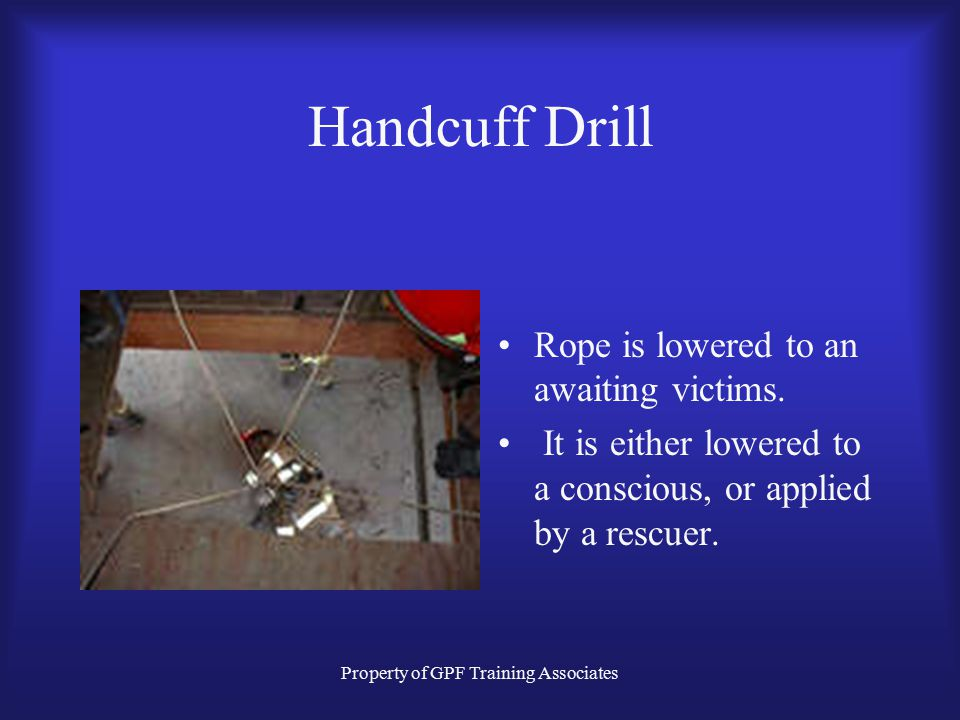 Property of GPF Training Associates Handcuff Drill Rope is lowered to an awaiting victims.
