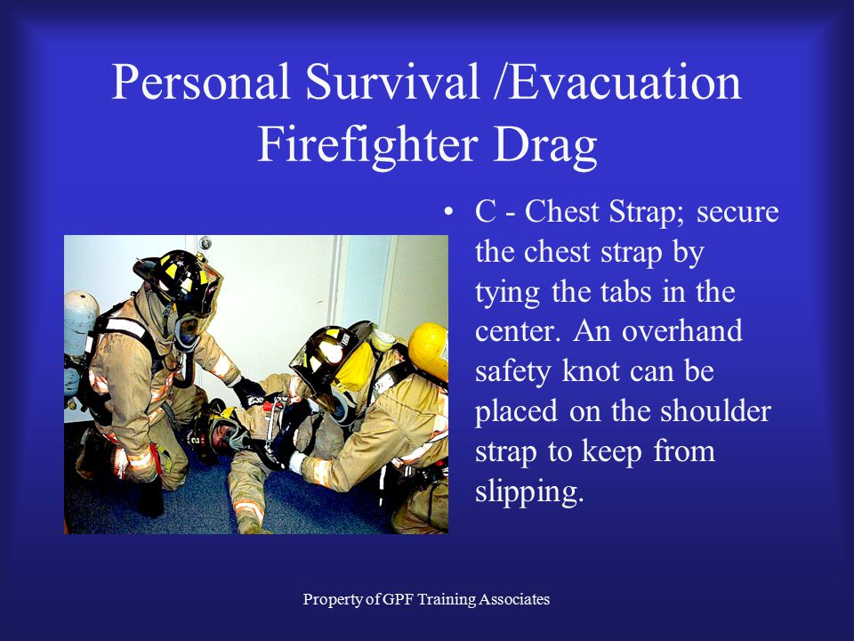 Property of GPF Training Associates Personal Survival /Evacuation Firefighter Drag C - Chest Strap; secure the chest strap by tying the tabs in the center.