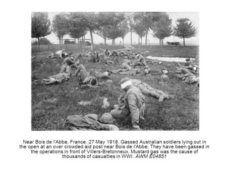 Near Bois de l'Abbe, France. 27 May 1918. Gassed Australian soldiers lying out in the open at an over crowded aid post near Bois de l'Abbe. They have been.