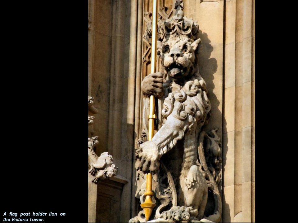 A flag post holder lion on the Victoria Tower.