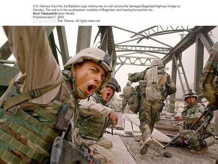 U.S. Marines from the 3rd Batallion urge infantrymen to rush across the damaged Baghdad Highway bridge on Monday. The unit is in the southeastern outskirts.