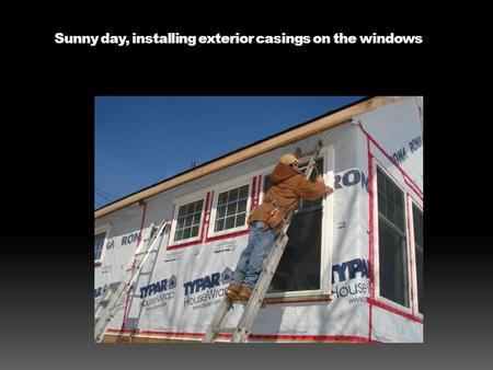 Sunny day, installing exterior casings on the windows.