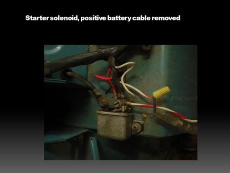 Starter solenoid, positive battery cable removed.