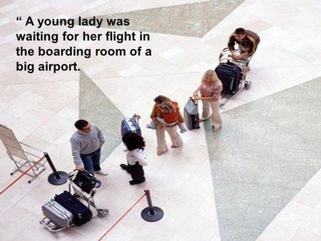 """ A young lady was waiting for her flight in the boarding room of a big airport."