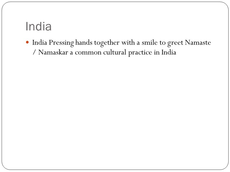 India India Pressing hands together with a smile to greet Namaste / Namaskar a common cultural practice in India.
